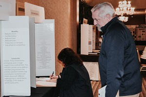 Janice and Bill judging posters